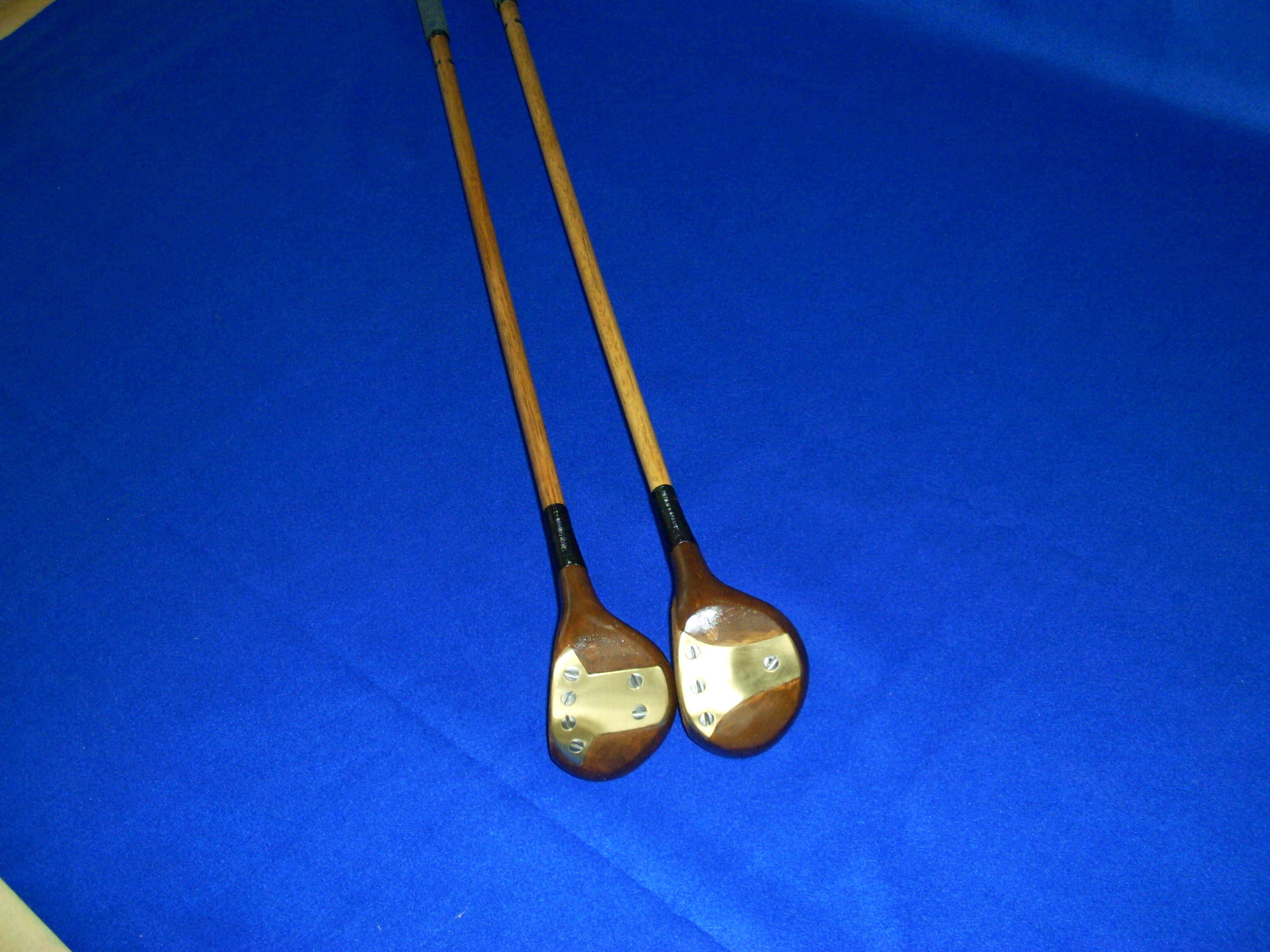 A PAIR OF WOODS 1 DRIVER,1 BRASSIE